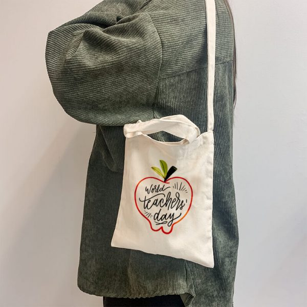 World's Teacher Day Mini Canvas Tote-bag, Custom our iTee template and make it yours. Model View
