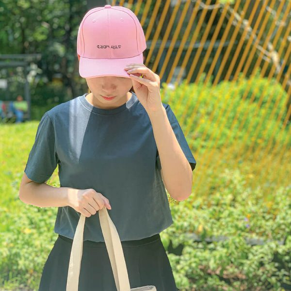 Stay Weird in Baby Pink Embroidered Cap, Custom our iTee template and make it yours. Model View